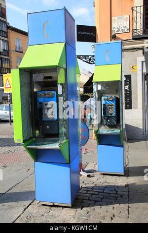 Telephone kiosk boxes in street, La Latina, Madrid city centre, Spain - Stock Photo
