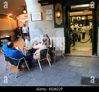 Chocolateria San Gines famous chocolate drink and churros cafe, Madrid city centre, Spain opened 1894 - Stock Photo