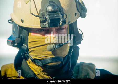 Close-up of United States Custom and Border Protection (USCBP) Air Interdiction Officer UH-60 Black Hawk helicopter pilot. Stock Photo