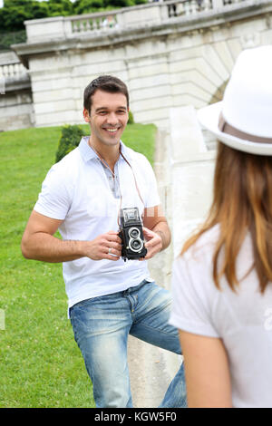 Man taking picture of girlfriend during journey - Stock Photo