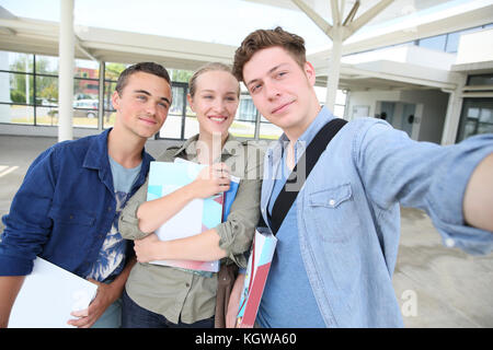 Students taking selfie picture in school campus - Stock Photo