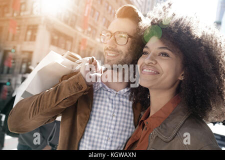 Cheerful couple doing shopping in Manhattan, New York city - Stock Photo