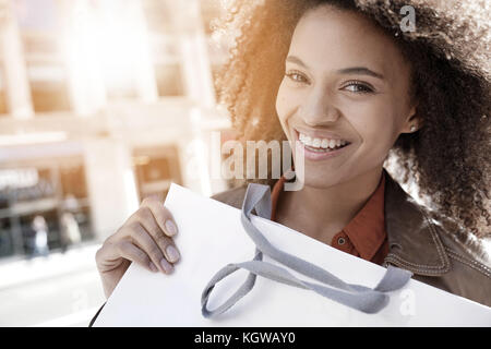 Cheerful girl doing shopping in New York City - Stock Photo