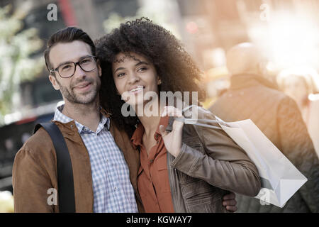 Cheerful couple doing shopping in New York city - Stock Photo