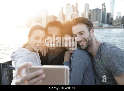 Friends taking selfie picture on Brooklyn heights promenade, NYC - Stock Photo