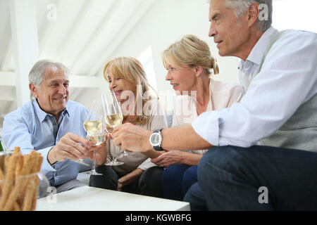 Group of senior people celebrating with champagne - Stock Photo