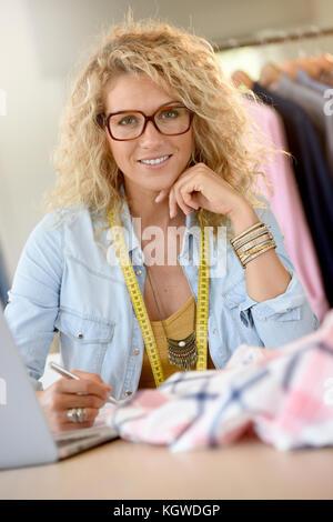 Beautiful woman fashion designer in office - Stock Photo