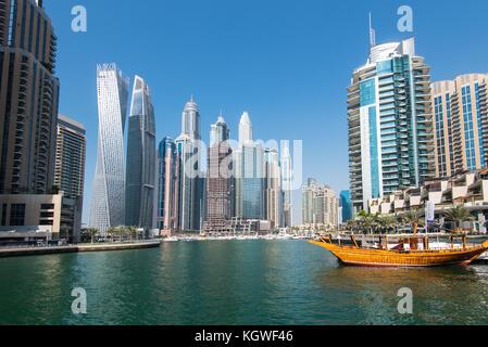 DUBAI, UAE - 31OCT2017: Iconic towers in Dubai Marina including (l-r) Cayan, Damac Heights, Marriott, Emirates Crown, - Stock Photo