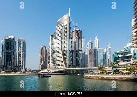 DUBAI, UAE - 31OCT2017: A water bus in Dubai Marina. - Stock Photo