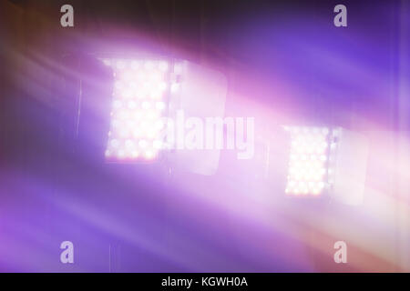 LED video and photography light on light stand in blurred background - Stock Photo