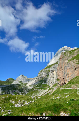 The alpine scenery at Mangrt Saddle or Mangartsko Sedlo on the Mangrt, which is the third highest peak in Slovenia - Stock Photo