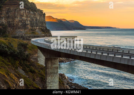 Sunset over the Sea cliff bridge along Australian Pacific ocean  - Stock Photo