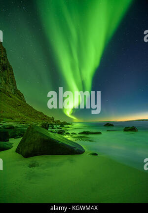 Beach in the Lofoten islands in Norway with northern lights - Stock Photo