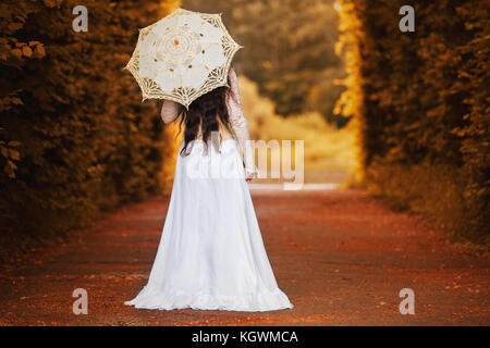 Mysterious woman in Victorian dress with back - Stock Photo