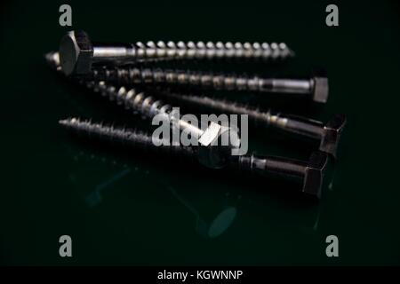 spanner with hexagon head bolt on a dark background - Stock Photo