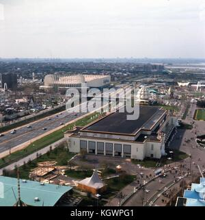 Panoramic aerial view facing northwest across the 1964 New York World's Fairgrounds toward LaGuardia Airport on - Stock Photo