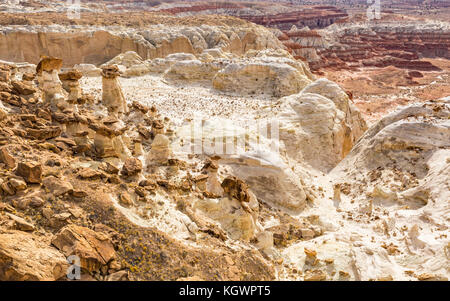 Brown, white and red layers of Entrada sandstone mix and create strange hoodoos at the Rimrocks area of Grand Staircase - Stock Photo