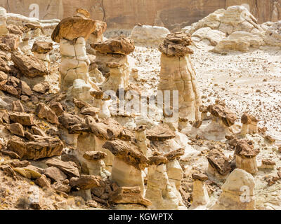 Brown and white layers of Entrada sandstone mix and create strange hoodoos at the Rimrocks area of Grand Staircase - Stock Photo