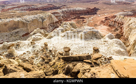 Brown, white and red layers of Entrada sandstone mix and create strage hoodoos at the Rimrocks area of Grand Staircase - Stock Photo