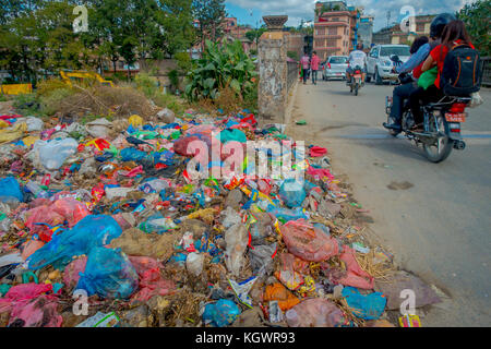 KATHMANDU, NEPAL OCTOBER 15, 2017: Food and pile of domestic garbage in landfill. Only 35 of population have access - Stock Photo