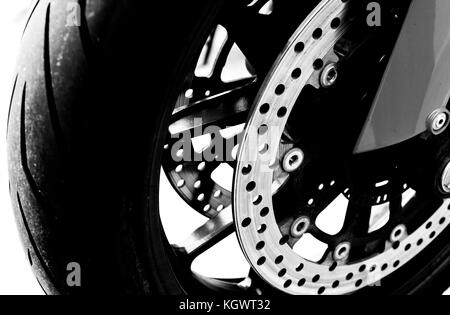 Isolated motorcycle front wheel in black and white / Close up view of motorcycle front wheel - Stock Photo