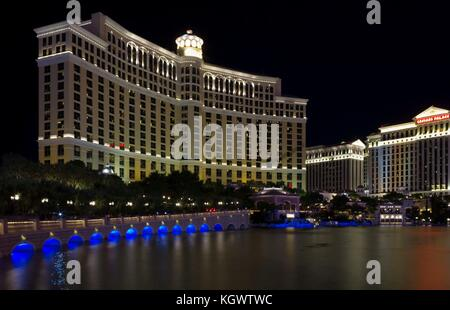 LAS VEGAS, USA - AUG 5: Night view of the famous Bellagio Hotel in Las Vegas, and the Caesars Palace, on August - Stock Photo