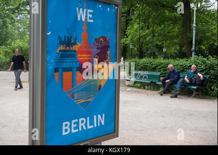 12.06.2017, Berlin, Germany, Europe - Two homeless men sit on a bench in Berlin's Tiergarten Park along Strasse - Stock Photo