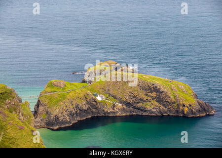Carrick-a-Rede Rope Bridge in Northern Ireland landscape near Ballintoy. - Stock Photo