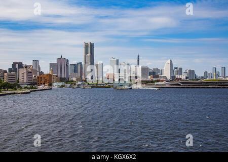 The Yokohama waterfront skyline seen from Tokyo Bay - Stock Photo
