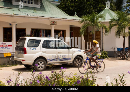 The Seychelles, La Digue, La Passe, Police Car parked opposite Police Station - Stock Photo