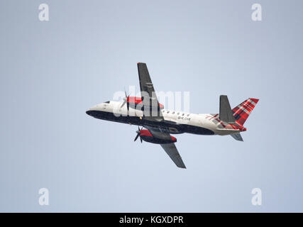 Loganair G-LGNN taxining prior to take off from Inverness Dalcross Airport. in the Scottish Highlands. - Stock Photo
