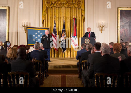 President Donald J. Trump presents the Medal of Honor to Retired U.S. Army Captain Gary M. Rose | October 23, 2017 - Stock Photo