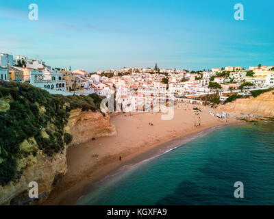 Beautiful beach and cliffs after sunset in Carvoeiro, Algarve, Portugal - Stock Photo