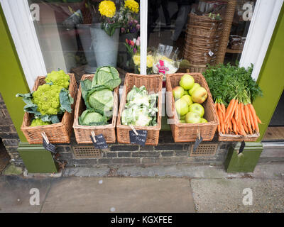 Fresh fruit and vegetables for sale outside a shop in the UK - Stock Photo