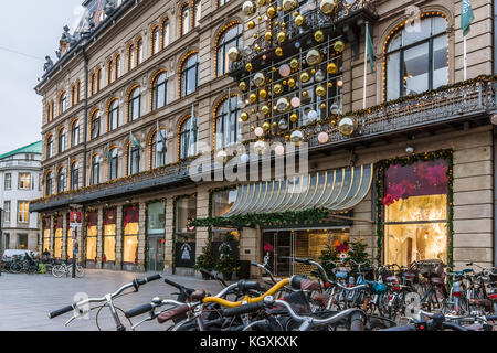 Christmas decorations and bikes at Magasin du Nord in Copenhagen, November 9, 2017 - Stock Photo