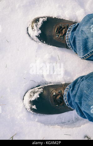 Left and Right Man's Foots in Snow from Top View - Stock Photo