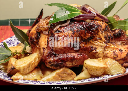 A Roast chicken with roast potatoes - Stock Photo