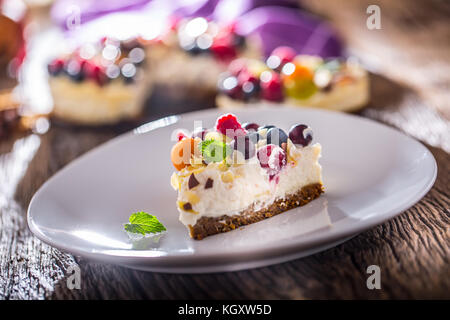 Cheescake with fresh fruit berries strawberries raspberries and star anise. Christmas cheescake with christmas decoration. - Stock Photo