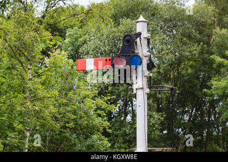 Railway Semaphore Signal.  An historic semaphore signal in the stop / danger position on the South Tynedale railway - Stock Photo