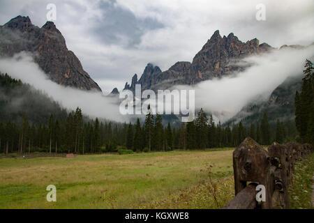 Mist in the dolomites, Fischleintal, Sexten, Pustertal, Bolzano, Trentino Alto Adige , Italy - Stock Photo