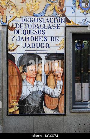 Historic ceramic tiles picture on restaurant wall, Calle Cava Baja, La Latina, Madrid, Spain - Stock Photo