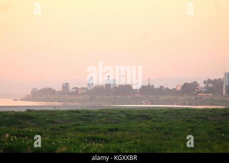 Sunset over the cityscape of Vientane, Laos - Stock Photo