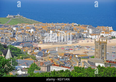 St Ives harbour from above,tides out with many beached boats.Look out post on hill. A bright sunny day in summer.Cornwall.UK. - Stock Photo