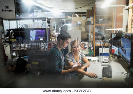 Female engineers using digital tablet in workshop - Stock Photo