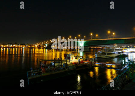 Night view of the Rhein River at Bonn in Germany. - Stock Photo