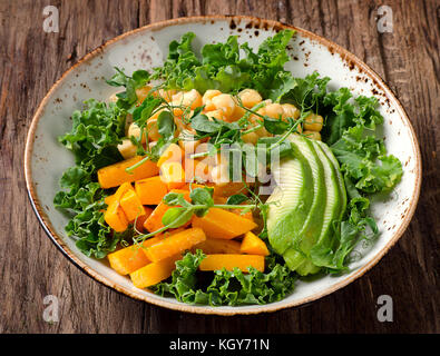 Chickpea, pumpkin and avocado vegetarian buddha bowl. Healthy food concept. Vegan food. - Stock Photo