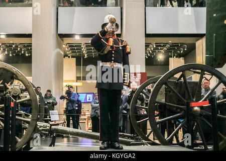 London, UK. 11th Nov, 2017. A Royal Marine Bugler plays the Last Post and Reveille at the Imperial War Museum London - Stock Photo