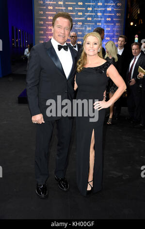 Arnold Schwarzenegger and his girlfriend Heather Milligan attend the 19th GQ Men of the Year Awards 2017 at Komische - Stock Photo