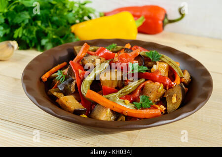 Vegetable stew (salad): bell pepper, eggplant, asparagus beans, garlic, carrot, leek. Bright spicy aromatic dishes. - Stock Photo