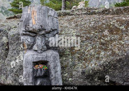 wooden statue of the Slavic god Perun in the Ergaki national park, Russia - Stock Photo